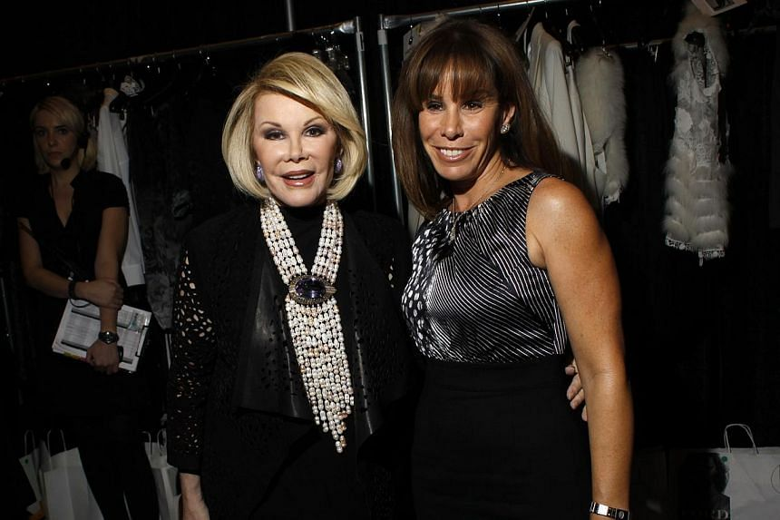Joan Rivers (left) and her daughter Melissa at the Elie Tahari Fall/Winter 2011 collection show during New York Fashion Week in 2011. -- PHOTO: REUTERS