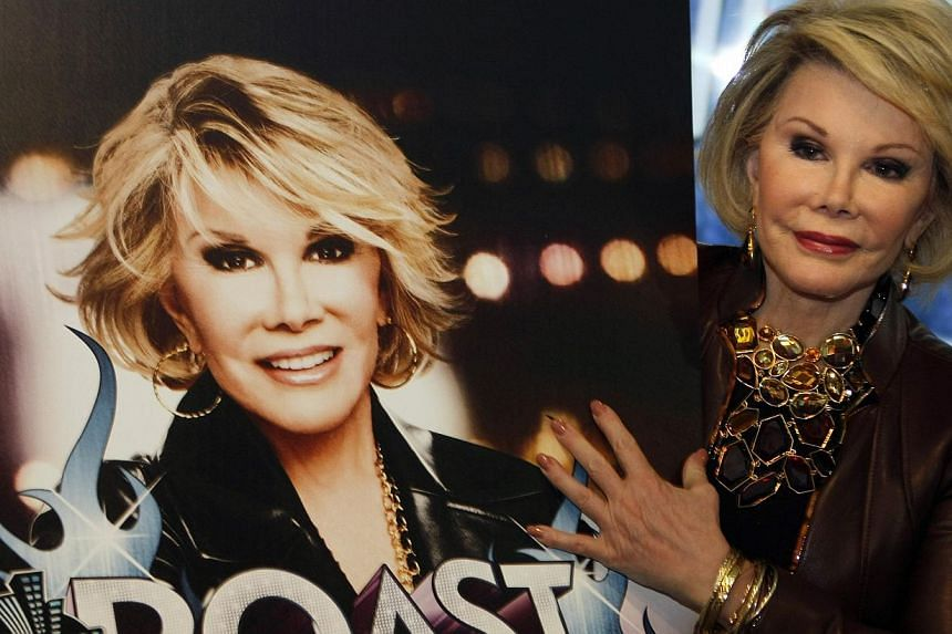 Joan Rivers posing for photographers as she presents Comedy Roast With Joan Rivers at the annual Mipcom television programme market in Cannes, south-eastern France, in 2009. -- PHOTO: REUTERS