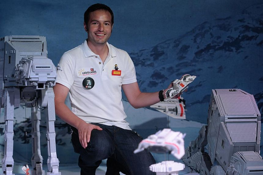 Mr Stefan Bentivoglio (above) and his team took about 8,000 man-hours to construct the displays, including Star Wars characters, Lego Imerial AT-AT Walkers and battle droids in formation. -- ST PHOTO: JOYCE FANG