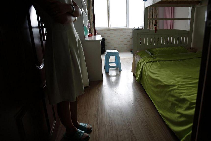 Liu, whose husband Lu was onboard Malaysia Airlines Flight MH370, shows a room which they prepared for their future babies in Beijing on July 18, 2014. They got married on March 1, a week before the incident, and could not go on a honeymoon due to he