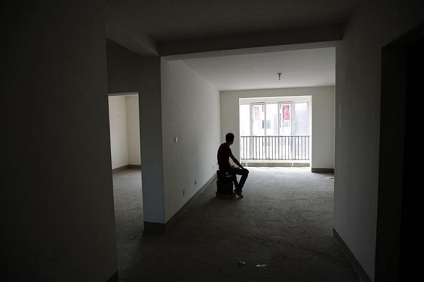 Zhiliang, whose fiancee was onboard Malaysia Airlines Flight MH370, in the empty house which he had planned to decorate with her for their marriage. Zhiliang said he will wait for his missing fiancee forever. They had planned to marry this year.&nbsp