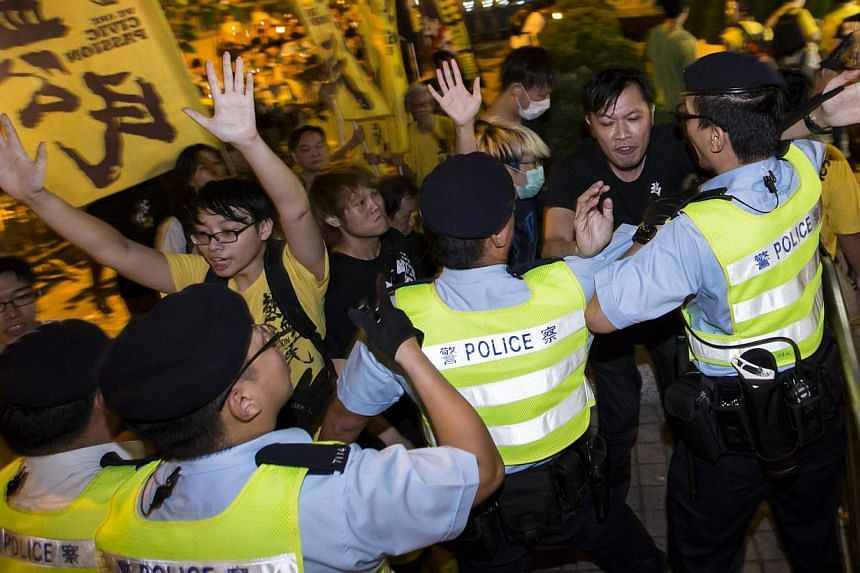 Pro-democracy activists clashing with the police during a protest outside the hotel where China's National People's Congress (NPC) Standing Committee Deputy General Secretary Li Fei is staying, in Hong Kong on Sept 1, 2014. NPC Standing Committee set