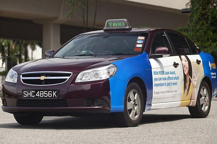 An SMRT Chevrolet Epica taxi. SMRT Road Holdings, a unit of SMRT Corp, has tied up with London-based taxi mobile application developer Hailo Network Holdings to introduce a taxi booking application for passengers and taxi drivers in Singapore. -- PHO