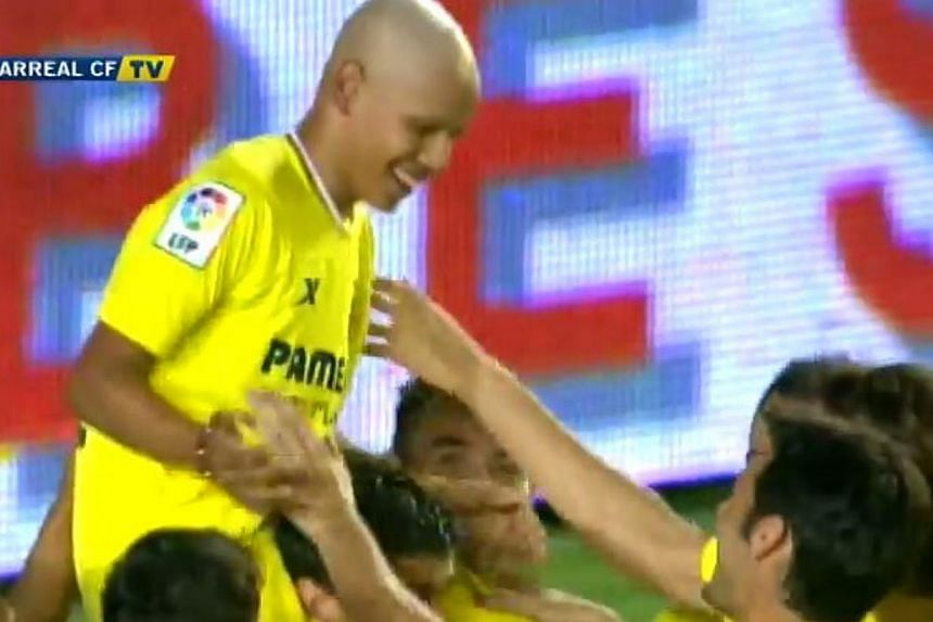 Villarreal fan Gohan, who is battling cancer, is mobbed by his teammates after he scores against Celtic in a friendly match. -- PHOTO: VILLARREAL CF/YOUTUBE