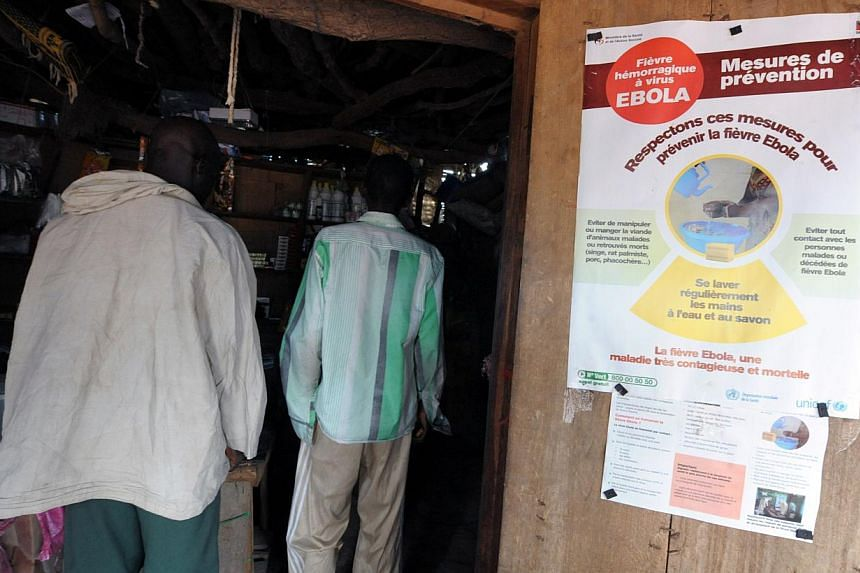 A preventive poster for the Ebola virus is seen on Sept 5, 2014 at the entrance of a shop in Dialadiang.The death toll from the Ebola epidemic has climbed above 2,000, the World Health Organisation (WHO) said on Friday, as it voiced hopes a vac