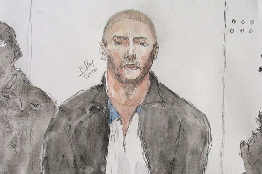 This court drawing made on June 26, 2014, shows Mehdi Nemmouche (centre), the 29-year-old suspected gunman in a quadruple murder at the Brussels Jewish Museum, during a court hearing in Versailles, France. A freed French hostage has said the sus