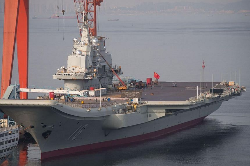 The Chinese aircraft carrier Liaoning docked at the seaport city of Dalian in northeast China's Liaoning province on July 6, 2014. Two pilots in a squadron conducting fighter jet take-off and landing tests for China's lone aircraft carrier were
