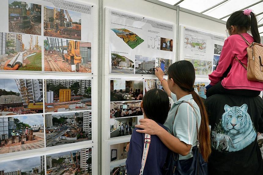 Residents and visitors of Mayflower looking at the pictures and graphic models of the future Mayflower Station.-- ST PHOTO:KUA CHEE SIONG