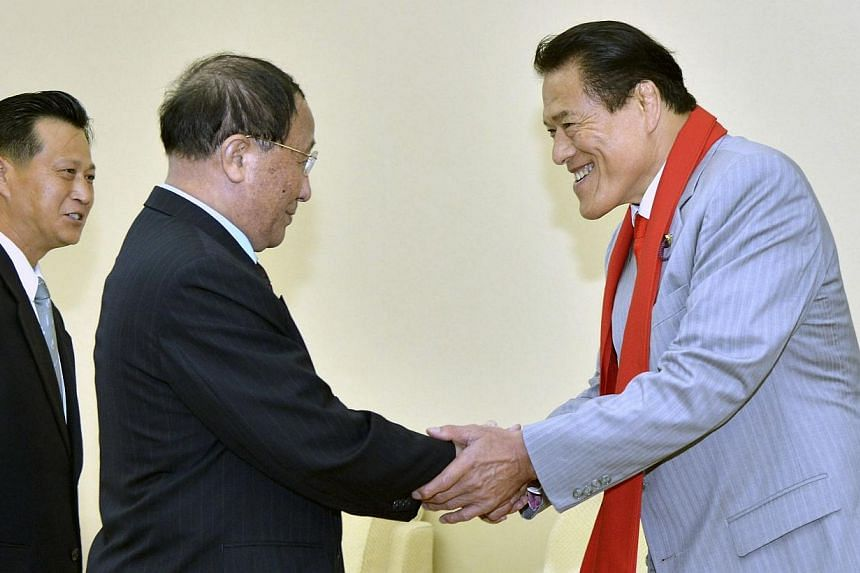 Mr Kang Sok Ju (centre), secretary of the Central Committee of the Workers' Party of Korea (WPK) and advisor to the North Korea-Japan Friendship Association, shakes hands with Kanji Inoki, a member of Japan's House of Councillors in this undated phot