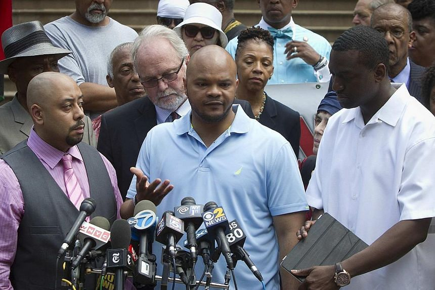 """(Front, from left)Wrongly convicted """"Central Park Five"""" members Raymond Santana, Kevin Richardson and Yusef Salaam attend a news conference announcing the payout for the case at City Hall in New York on June 27, 2014.A US federal judge ha"""