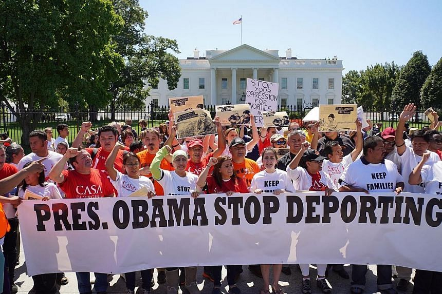 Immigrant rights activists shout slogans in front of the White House on Aug 28, 2014 in Washington, DC.United States President Barack Obama will wait until after November's mid-term elections to reform the US immigration system, in a clear bid