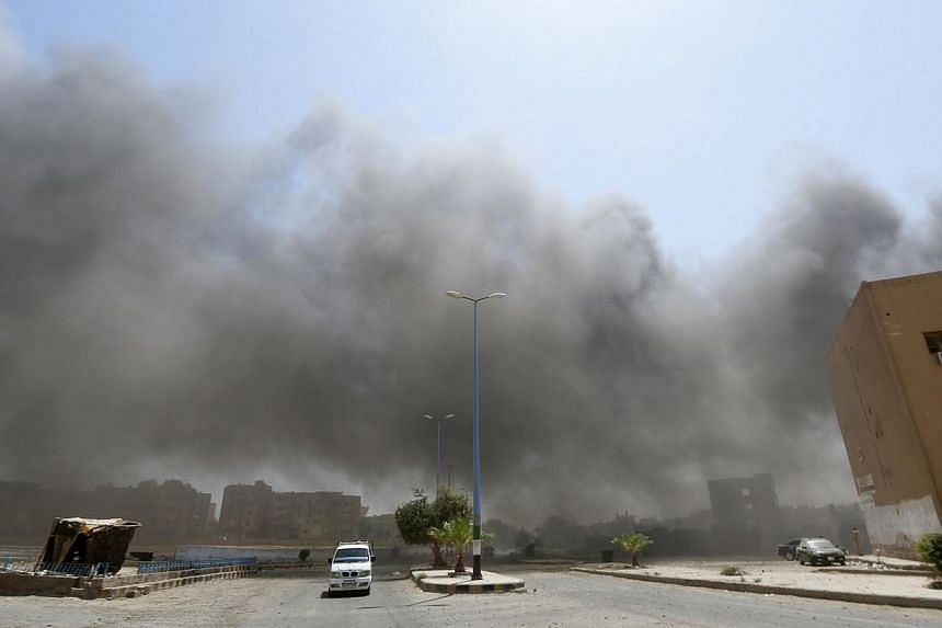 Smoke rises after what activists say was shelling from forces loyal to Syria's President Bashar al-Assad in Raqa on Aug 17, 2014. Syrian air strikes in the jihadist-held northern city of Raqa on Saturday, Sept 6, 2014, killed 31 people, includin