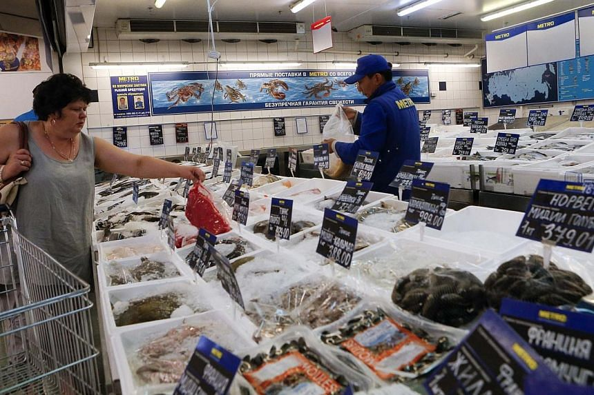 Seafood is on sale at a Metro Cash and Carry store in Moscow on Aug 8, 2014. Russia warned on Saturday, Sept 6, 2014, that it would react if the European Union imposed fresh economic sanctions against it over the situation in Ukraine. -- PHOTO: