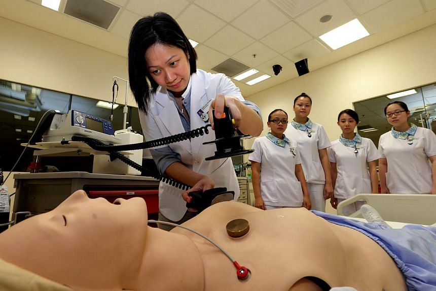 Nurse educator Kathy Lam demonstrates how to perform resuscitation at the Khoo Teck Puat Hospital. People looking to make the mid-career switch to become nurses, physiotherapists, occupational therapists or diagnostic radiographers, can now look forw