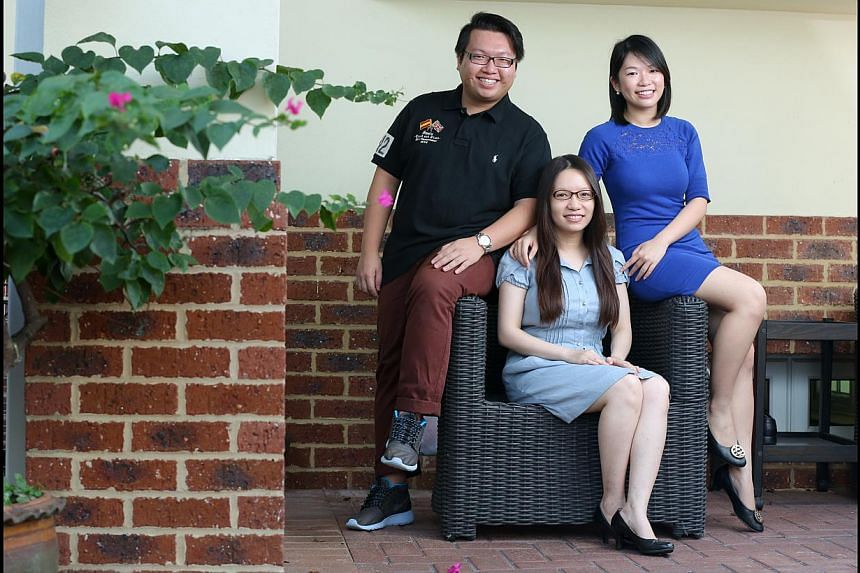 Lawyer Janis Leong (centre), 31, and her sister Rachel, 24, are law graduates of the University of Liverpool. Their brother Gary, 25, is now pursuing the same degree at the university.