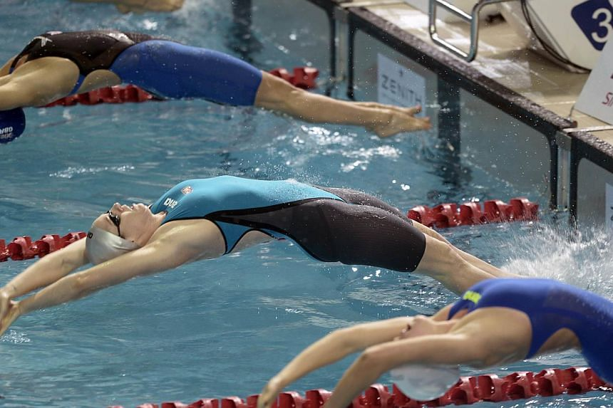 Emily Seebohn (centre) of Australia dives in the women's 100 LC metre backstroke during the Prudential Singapore Swim Stars on Sept 5, 2014. The Prudential Singapore Swim Stars inaugural one-day swimming event saw the participation of 12 Olympic Cham