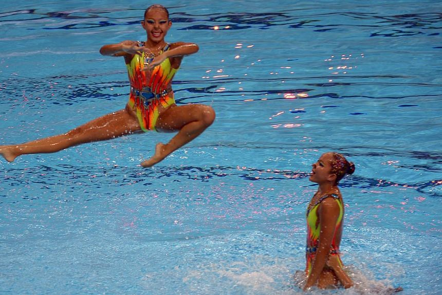 Singapore sync team, perform during the Prudential Singapore Swim Stars inaugural one-day swimming event on Sept 5, 2014. -- PHOTO: AFP