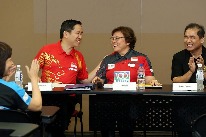 Newly-elected STTA president Ellen Lee (second from right) shares a light moment with deputy presidents Alex Yam (second from left) and Jack Soh (right) and former president Lee Bee Wah (left).-- ST PHOTO:SEAH KWANG PENG