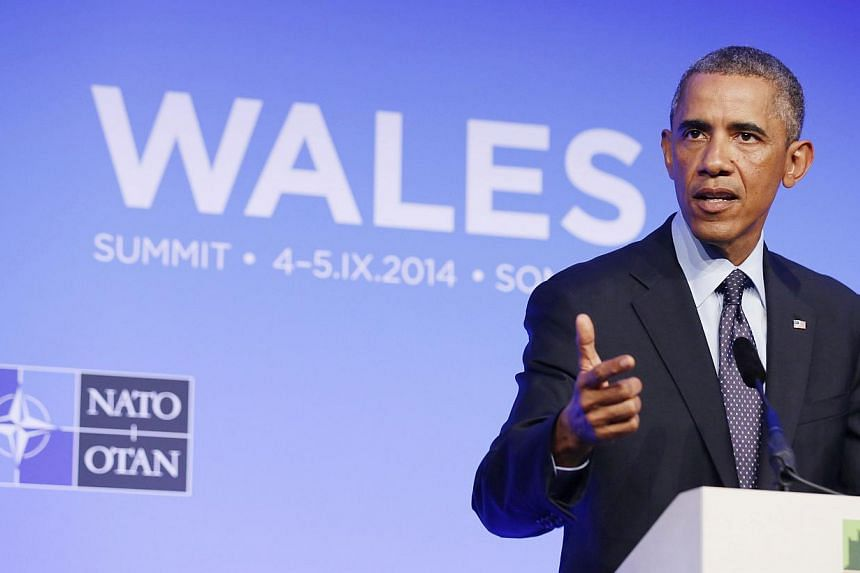 US President Barack Obama speaks at a news conference at the conclusion of the Nato Summit at the Celtic Manor Resort in Newport, Wales Sept 5, 2014. -- PHOTO: REUTERS