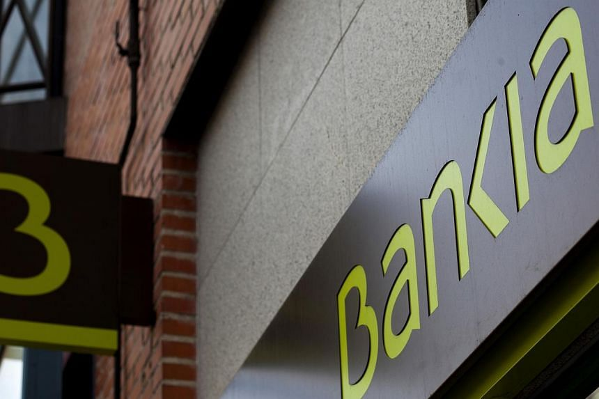A logo sits on display outside a Bankia SA bank branch in Madrid, Spain, on Friday, Jan 10, 2014. Spanish banks will seek around 30 billion euros (S$48.7 billion) in loans from the European Central Bank's programme to spur lending to businesse