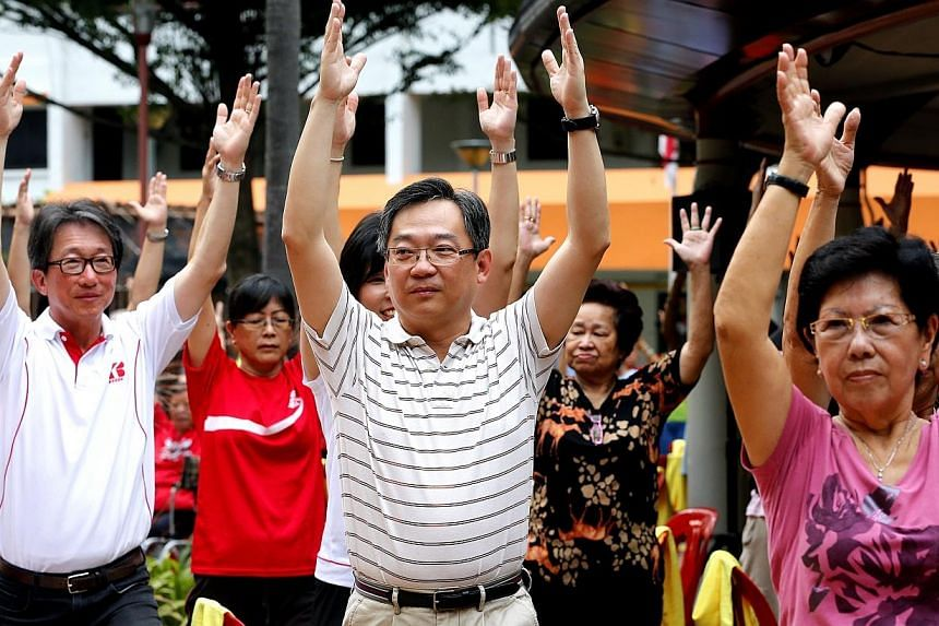 Minister in the Prime Minister's Office Lim Swee Say (left) and Health Minister Gan Kim Yong (centre) joining the yoga exercises and attending an event on the Bedok Community For All Ages Journey, a grassroots programme to address the needs of v