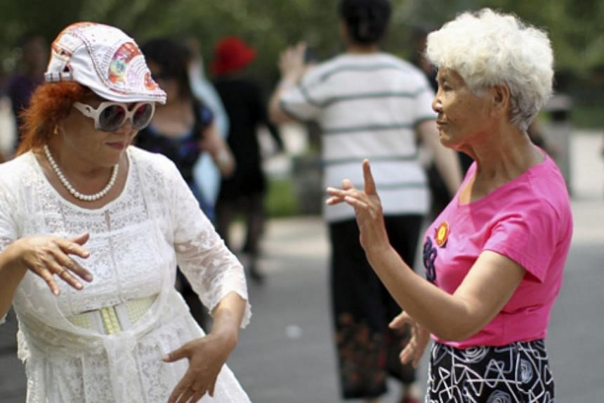 """""""Da ma"""" - women, mostly middle-aged or retired and freed from the constraints of work and raising children - dance in public spaces around China in the mornings and evenings. They have been blamed for taking up too much public space and dancing in th"""