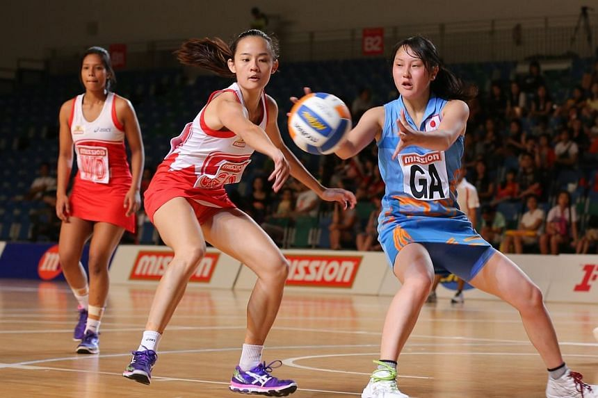 The Singapore national netball team began the defence of their Mission Foods Asian Netball Championships with a resounding 67-13 victory over Group A opponents Japan on Sunday.-- ST PHOTO: ONG WEE JIN