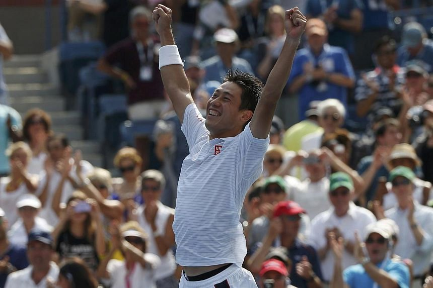 Kei Nishikori of Japan celebrates after defeating Novak Djokovic of Serbia in their semi-final match at the 2014 US.Open tennis tournament in New York, on Sept 6, 2014.-- PHOTO: REUTERS