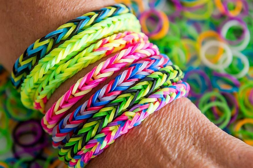 Tens of thousands of the original Rainbow Loom kit, which retails at $29.90 and is made in China, have been sold in Singapore. --PHOTO: AFP