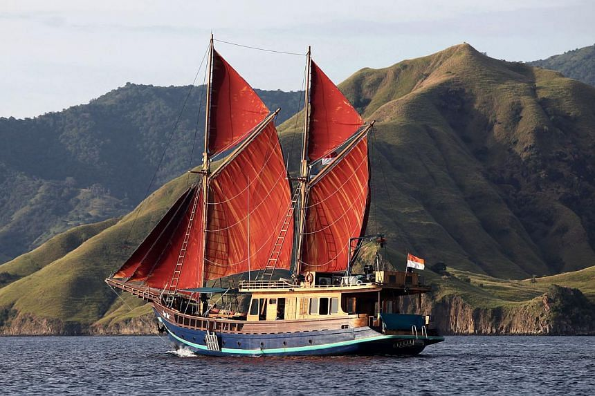 Tiger Blue, a 34m traditional Bugis schooner with contemporary comforts, sails around Komodo and other parts of Indonesia. -- PHOTO: TIGER BLUE