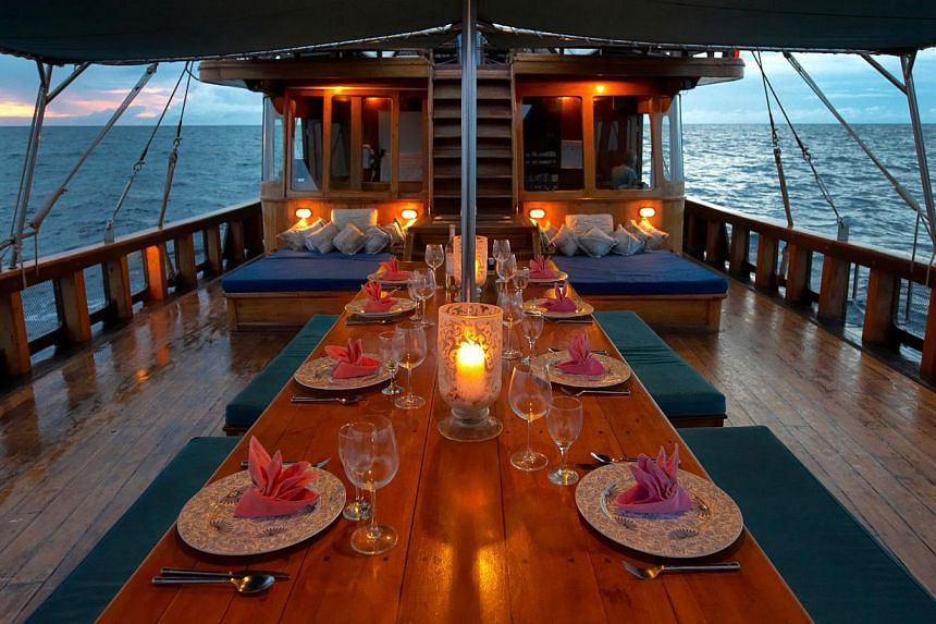 Guests on the Tiger Blue schooner can enjoy sumptuous meals on board and sundowners on uninhabited islands. -- PHOTO: TIGER BLUE