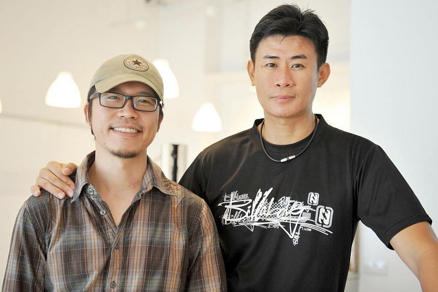Adrian Loh (right) and Wee Phang Lui (left, with spectacles). -- ST PHOTO: AZIZ HUSSIN