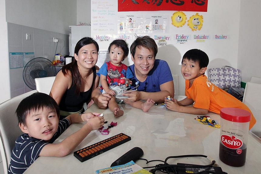 Magician Derrick Lee, 36, and his wife Mrs Sophia Lee, 34, homeschool their three children Prince Ranen Lee, 7, Jethro Wise Lee, 5, and Asher Noah Lee, 2. -- ST PHOTO: NEO XIAOBIN