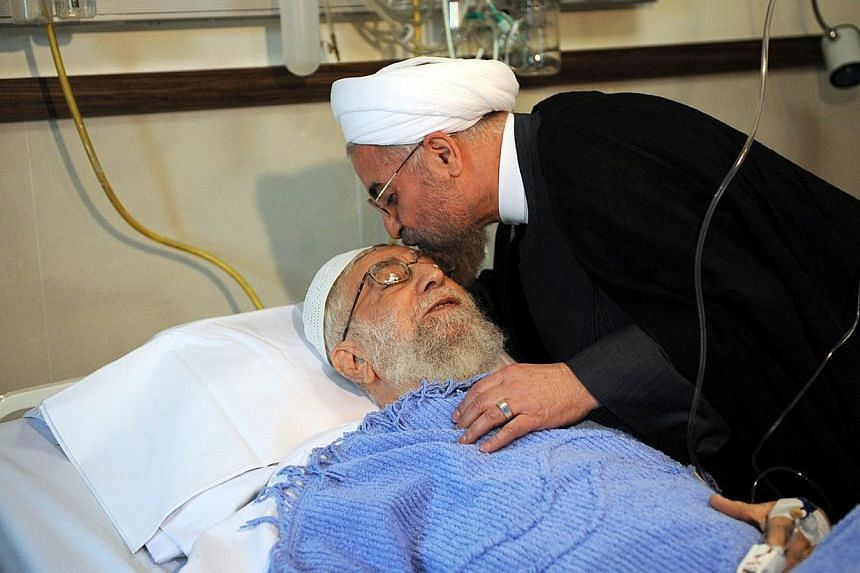 Iranian President Hassan Rouhani visiting Iran's Supreme leader Ayatollah Ali Khamenei after the latter's prostate operation at a hospital in Teheran onMonday, Sept 8, 2014. The Ayatollah successfully underwent prostate surgery, it was anno