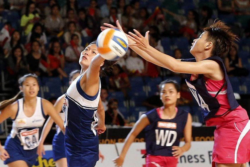 Singapore (in blue) defeated Group A opponents Vietnam 84-8 at the Mission Foods Asian Netball Championships. -- ST PHOTO: CHEW SENG KIM