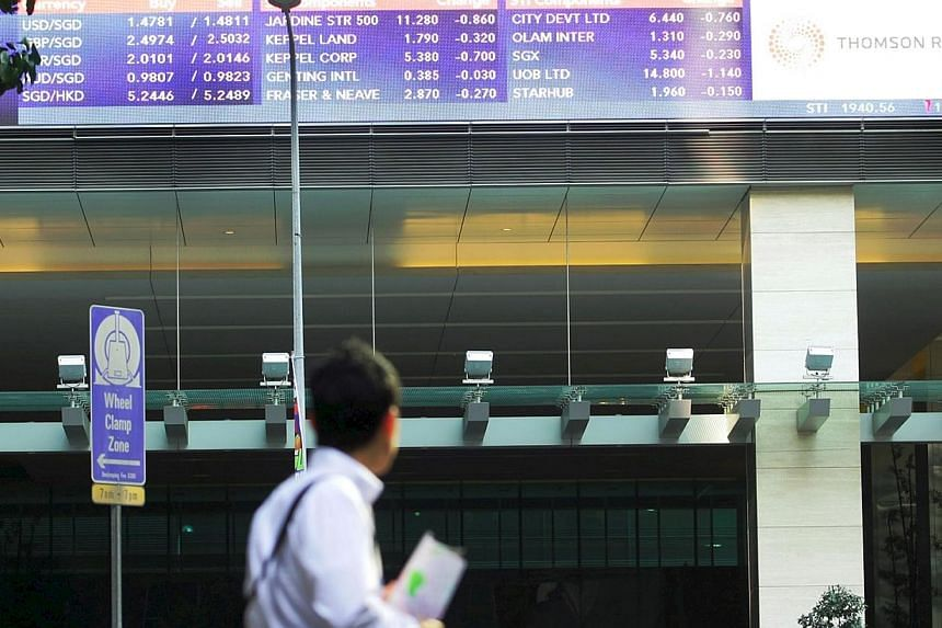 The local stock market endured yet another listless day of trade, with the Straits Times Index (STI) closing 6.5 points or 0.2 per cent lower at 3,335.2. -- PHOTO: ST FILE