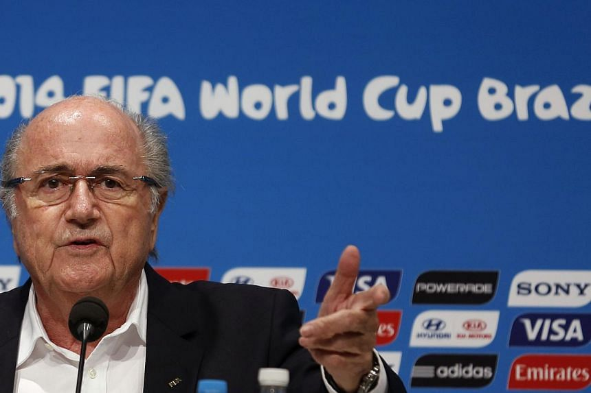 Fifa President Sepp Blatter speaks during a news conference at the Maracana stadium in Rio de Janeiro on July 14, 2014. Mr Blatter will stand for re-election as Fifa president next year, he confirmed on Monday, Sept 8, 2014. -- PHOTO: REUTERS