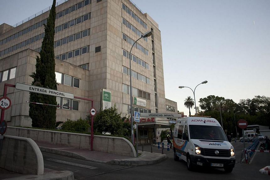 An ambulance carrying British cancer patient Ashya King leaves a hospital in Malaga on Sept 8, 2014.Ashya King, the five-year-old cancer patient whose parents triggered an international hunt when they took him from Britain to seek alternative c