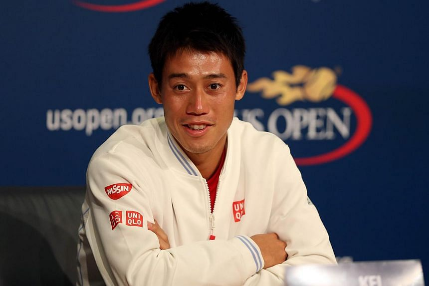 Kei Nishikori of Japan speaks to the media after defeating Novak Djokovic of Serbia in their men's singles semifinal match on Day 13 of the 2014 US Open at the USTA Billie Jean King National Tennis Center on Sept 6, 2014, in New York City. -- PHOTO: