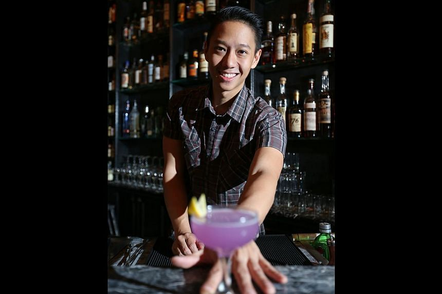 Bartender Peter Chua with a cocktail he made at the Diageo Reserve World Class global finals called The Violet Watch, which uses ingredients such as lemon juice and homemade butterfly pea curacao syrup.