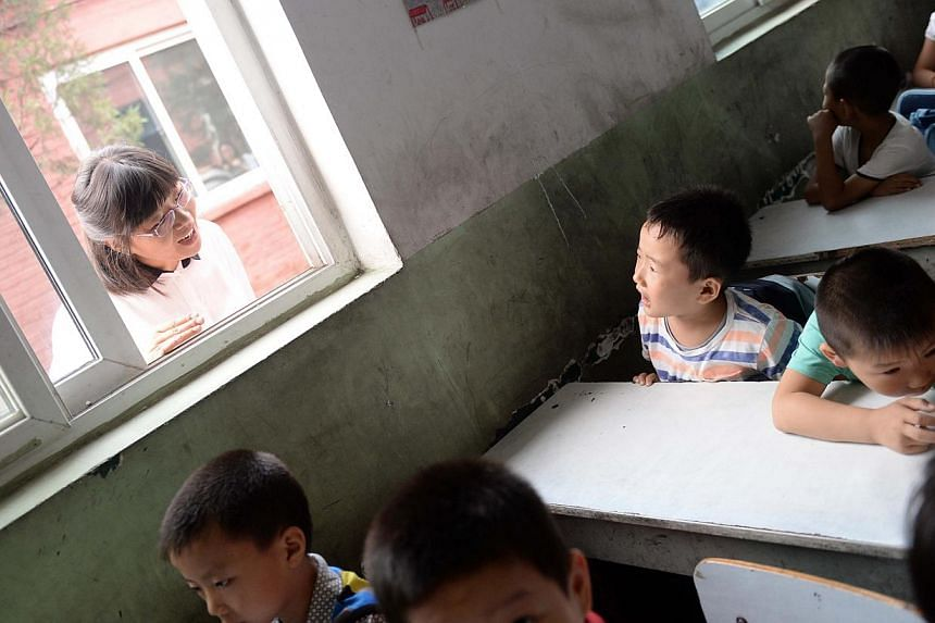 Pupils at a non-formal private school for the children of migrant workers in Beijing. A huge gap exists in educational opportunities between students from rural areas and those from cities.