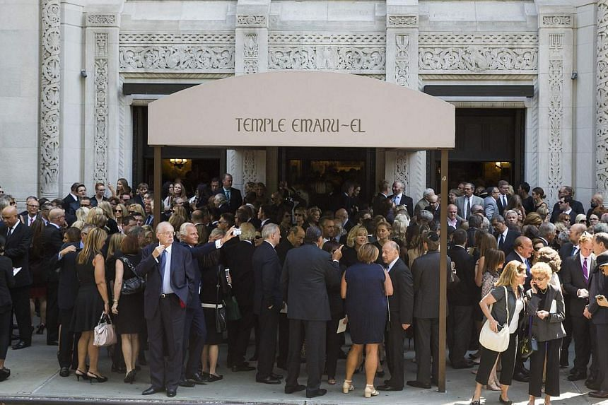 Mourners depart the funeral of comedian Joan Rivers at Temple Emanu-El in New York on Sept 7, 2014. -- PHOTO: REUTERS