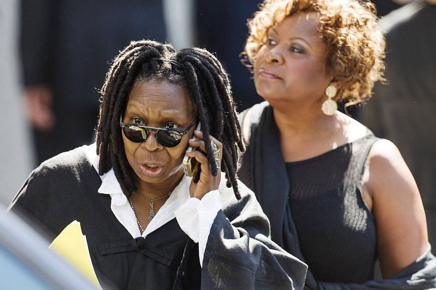 Comedian Whoopi Goldberg departs the funeral of comedian Joan Rivers at Temple Emanu-El in New York on Sept 7, 2014. -- PHOTO: REUTERS