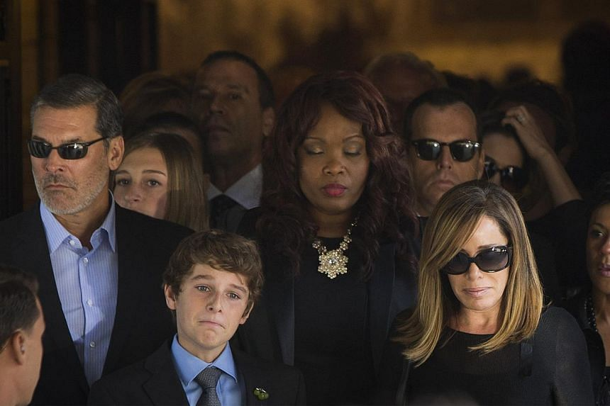 Melissa Rivers and her son Cooper depart the funeral of her mother, comedian Joan Rivers, at Temple Emanu-El in New York on Sept 7, 2014. -- PHOTO: REUTERS