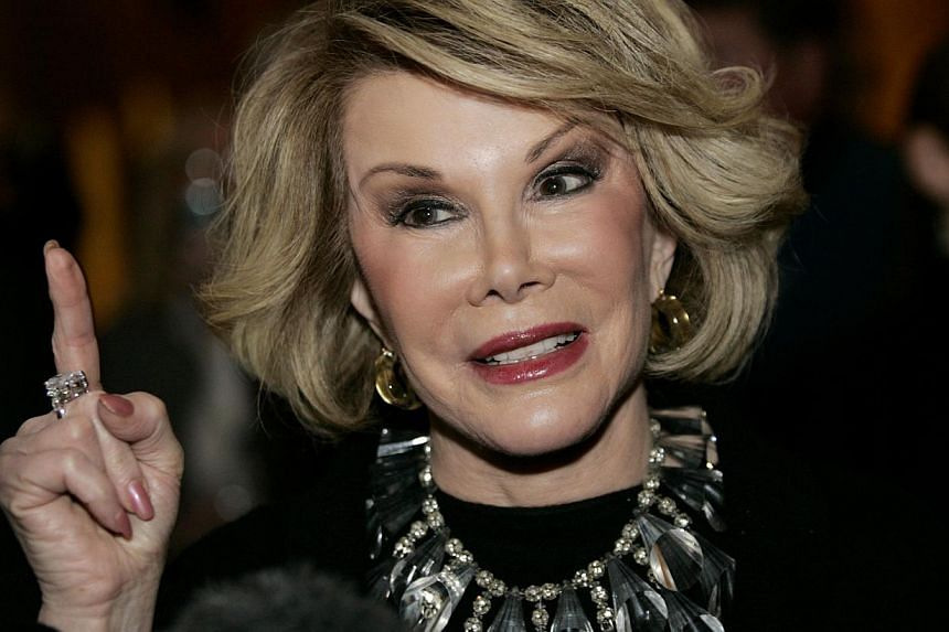 Comedian Joan Rivers talks to reporters as she arrives for a gala honoring the late stand-up comedian George Carlin, the 11th Annual Mark Twain Prize for American Humor recipient, at the Kennedy Center in Washington, in this Nov 10, 2008 file photo.