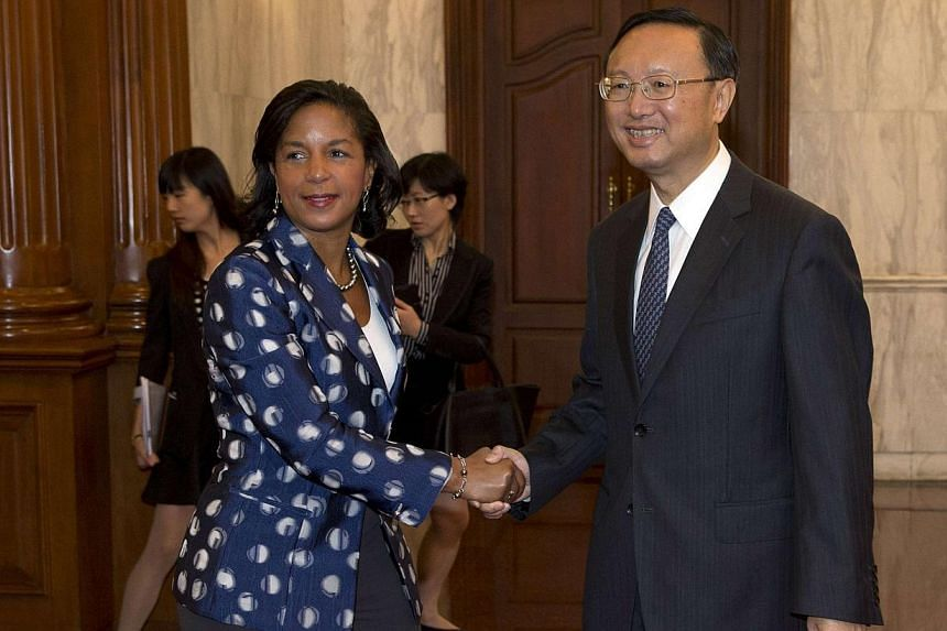 US National Security Advisor Susan Rice (left) shakes hands with Chinese State Councillor Yang Jiechi before a meeting at the Diaoyutai State Guesthouse in Beijing, on Sept 8, 2014. -- PHOTO: REUTERS