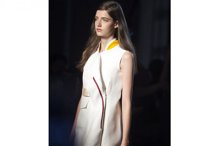 A model presents a creation during the Victoria Beckham Spring/Summer 2015 collection during New York Fashion Week in the Manhattan borough of New York on Sept 7, 2014. -- PHOTO: AFP