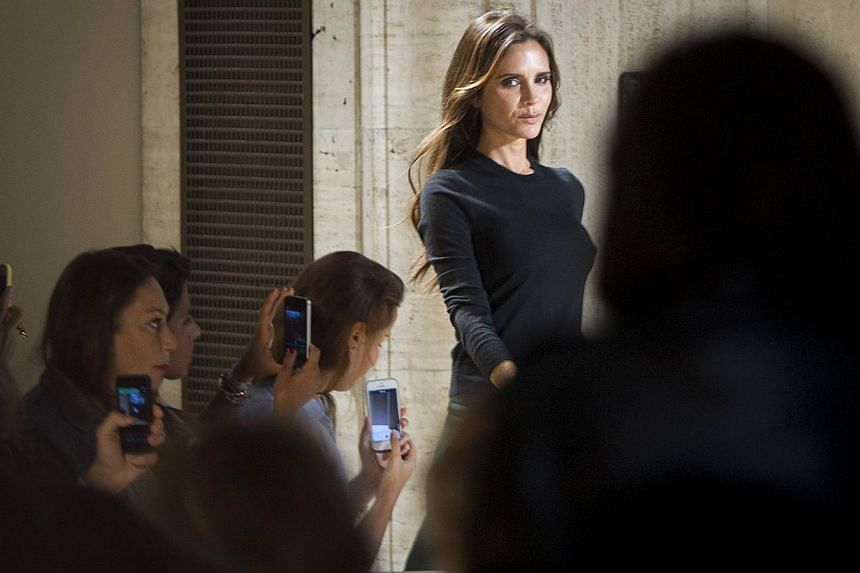 Designer Victoria Beckham walks onto the runway following her Spring/Summer 2015 collection show during New York Fashion Week in the Manhattan borough of New York on Sept 7, 2014. -- PHOTO: REUTERS