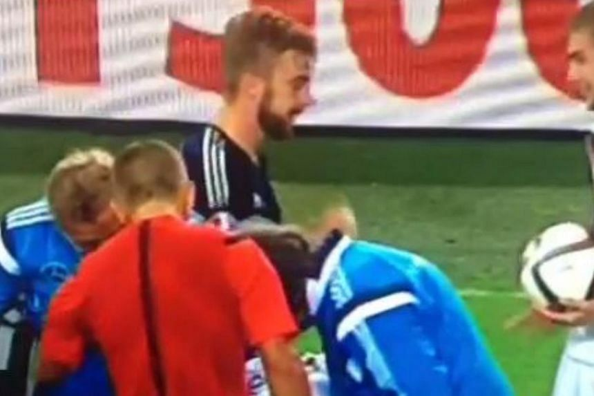 Scotland's James Morrison and Germany's Christoph Kramer sneak in a round of rock-paper-scissors during their countries' Euro 2016 qualifier. -- PHOTO: SCREENGRAB FROM VINE