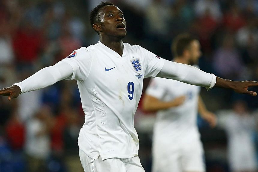 England's Danny Welbeck celebrates his second goal against Switzerland during their Euro 2016 qualifying soccer match at the Sankt Jakob-Park stadium in Basel on Sept 8, 2014. -- PHOTO: REUTERS